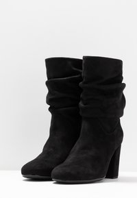 Unisa - OLISE - Bottines - black - 4