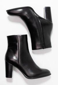 Unisa - UGO - Kotníková obuv na vysokém podpatku - black - 3
