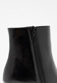 Unisa - UGO - Kotníková obuv na vysokém podpatku - black - 2