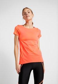 Under Armour - T-shirts - orange - 0