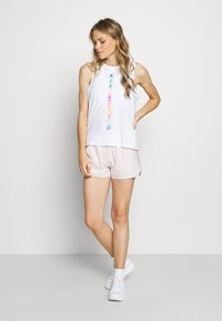 Under Armour - PRIDE FASHION GRAPHIC TANK - Sports shirt - white