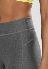 Under Armour - ANKLE CROP - Tights - charcoal light heath