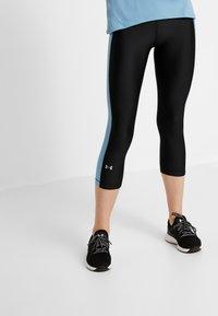 Under Armour - CAPRI - Pantalon 3/4 de sport - black - 0