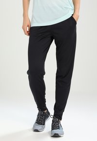 Under Armour - PLAY UP PANT SOLID - Pantalones deportivos - black - 0