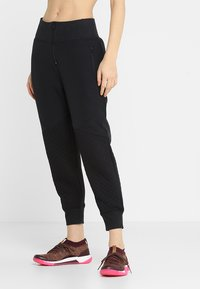 Under Armour - UNSTOPPABLE MOVE LIGHT REACTOR PANT - Tracksuit bottoms - black - 0