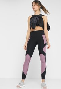 Under Armour - Legginsy - black - 1