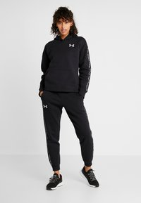 Under Armour - ORIGINATORS JOGGER - Trainingsbroek - black/white - 1