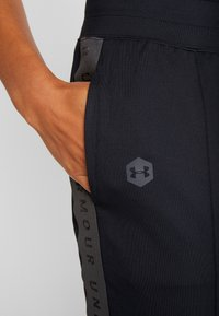 Under Armour - ATHLETE RECOVERY TRAVEL PANT - Tracksuit bottoms - black/jet gray - 3