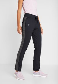 Under Armour - ATHLETE RECOVERY TRAVEL PANT - Tracksuit bottoms - black/jet gray - 0