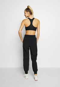 Under Armour - RECOVER PANTS - Verryttelyhousut - black/onyx white - 2