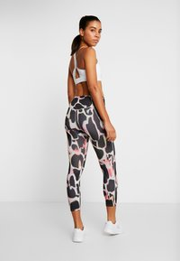 Under Armour - RUSH ELECTRIC PRINTED CROP - Tights - black