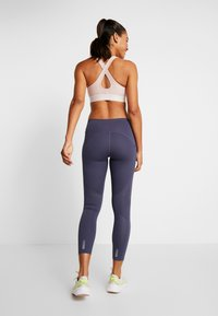 Under Armour - QUALIFIER SPEEDPOCKET PERFORATED ANKLE CROP - Leggings - blue ink - 2