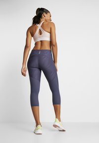 Under Armour - FLY FAST CROP - 3/4 sports trousers - blue ink - 2