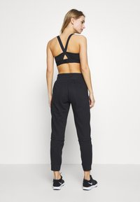 Under Armour - PROJECT ROCK TERRY - Trainingsbroek - black full heather - 2