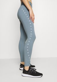 Under Armour - FAVORITE GRAPHIC LEGGING - Collant - hushed turquoise/halo gray/halo gray - 3