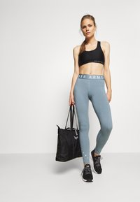 Under Armour - FAVORITE GRAPHIC LEGGING - Collant - hushed turquoise/halo gray/halo gray - 1