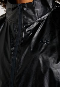 Under Armour - ANORAK - Giacca sportiva - black - 7