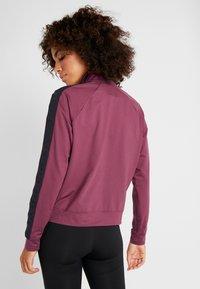 Under Armour - ATHLETE RECOVERY TRAVEL JACKET - Training jacket - level purple/black - 2