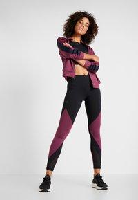 Under Armour - ATHLETE RECOVERY TRAVEL JACKET - Training jacket - level purple/black - 1