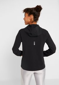 Under Armour - QUALIFIER OUTRUN THE STORM JACKET - Hardloopjack - black - 2