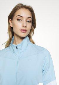 Under Armour - UA WINDSTRIKE FULL ZIP - Waterproof jacket - white/blue frost - 3