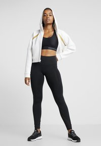 Under Armour - MISTY SIGNATURE SPACER FULL ZIP - Hoodie met rits - onyx white/palm green - 1