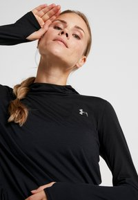 Under Armour - STREAKER LONG SLEEVE HOODIE - Funkční triko - black - 4