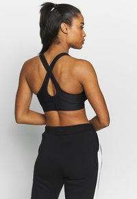 Under Armour - ARMOUR MID CROSSBACK BRA - Urheiluliivit - black/graphite