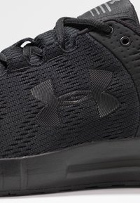 Under Armour - MICRO G PURSUIT - Neutral running shoes - black - 5
