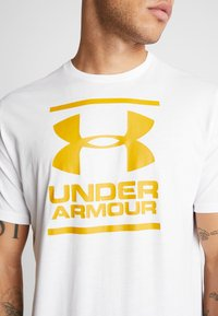 Under Armour - FOUNDATION - Print T-shirt - white/golden yellow