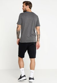 Under Armour - FOUNDATION - T-shirt imprimé - charcoal medium heather/graphite/black - 2