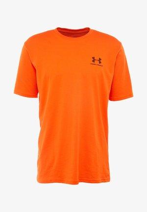 SPORTSTYLE LEFT CHEST - T-shirt basic - ultra orange/black
