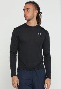 Under Armour - STREAKER LONGSLEEVE - Sports shirt - black/reflective - 0