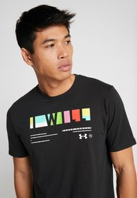 Under Armour - I WILL  - T-shirt med print - black/white - 4
