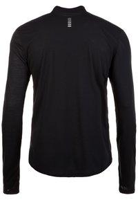 Under Armour - STREAKER - Sports shirt - black - 1