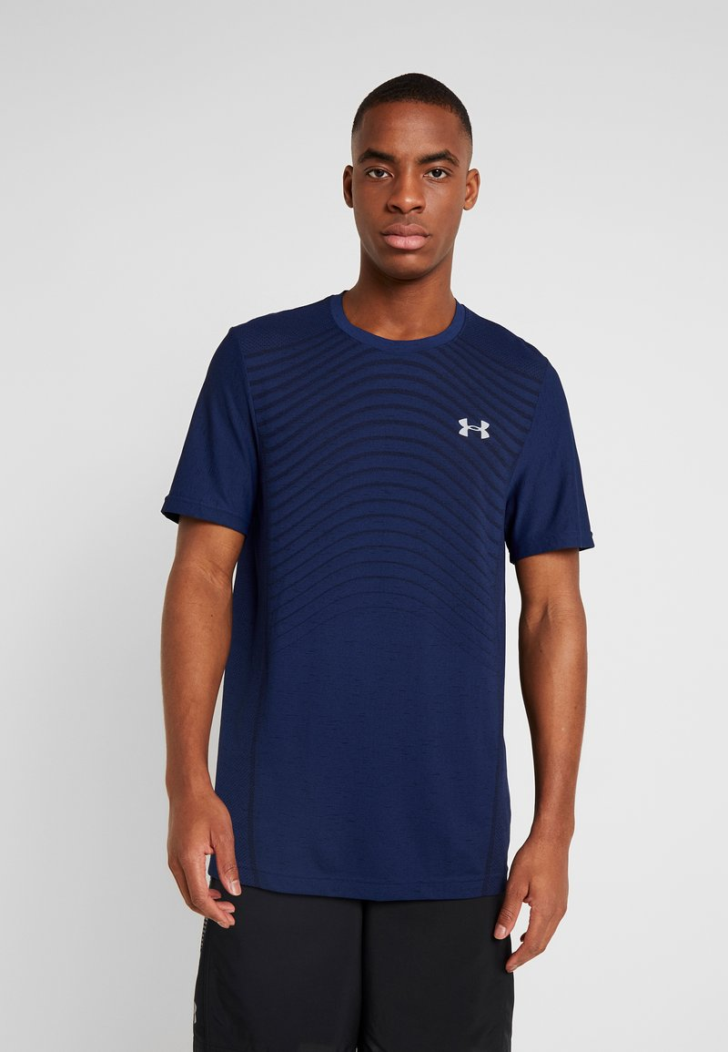 Under Armour - SEAMLESS WAVE - T-shirt med print - american blue/mod gray