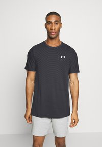 Under Armour - SEAMLESS WAVE - T-shirt med print - black/mod gray - 0