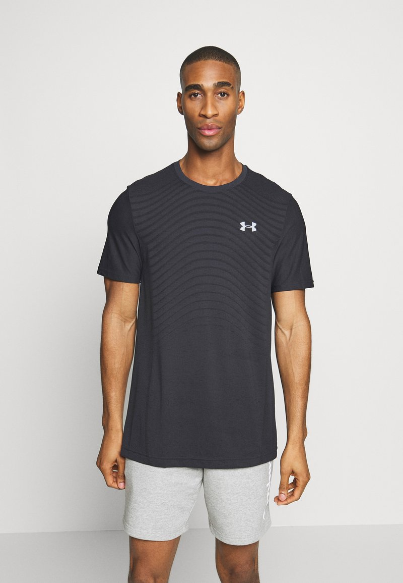 Under Armour - SEAMLESS WAVE - T-shirt med print - black/mod gray