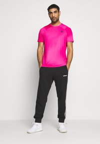 Under Armour - RUSH FITTED PRINTED - Triko s potiskem - pink surge - 1