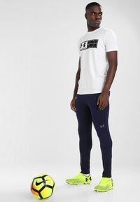 Under Armour - Tracksuit bottoms - midnight navy - 1