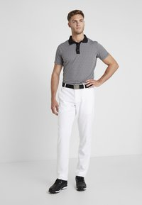 Under Armour - TAKEOVER GOLF PANT TAPER - Chinot - white - 1