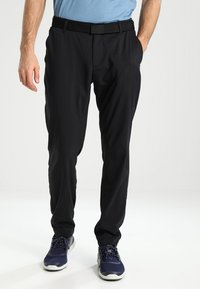 Under Armour - TAKEOVER GOLF PANT TAPER - Chino - black - 0