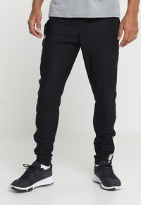 Under Armour - ALLSEASONGEAR SPORTSTYLE TRAININGSHOSE HERREN - Tracksuit bottoms - black/white - 0
