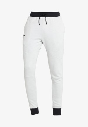 UNSTOPPABLE JOGGER - Tracksuit bottoms - onyx white/black