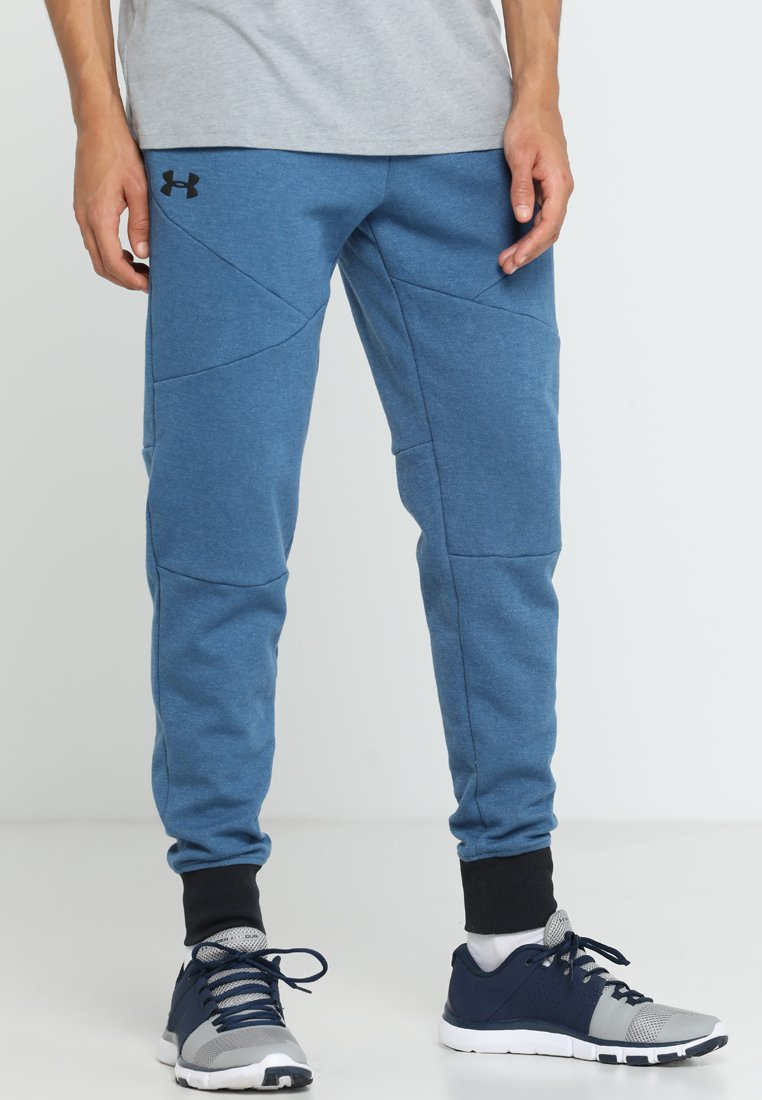 Under Armour - UNSTOPPABLE JOGGER - Tracksuit bottoms - petrol blue/black