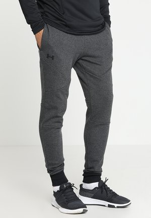 UNSTOPPABLE JOGGER - Tracksuit bottoms - black/black
