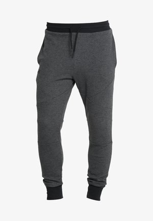 UNSTOPPABLE JOGGER - Trainingsbroek - black/black