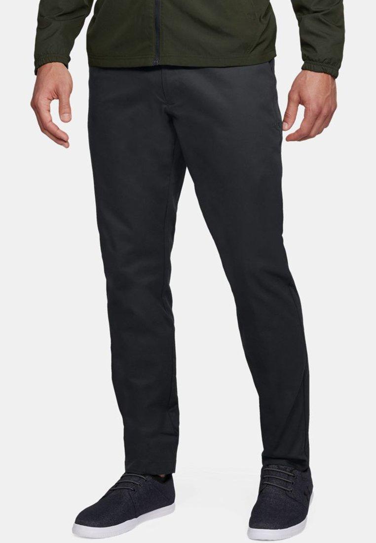 Under Armour - SHOWDOWN CHINO TAPER PANT - Kalhoty - black
