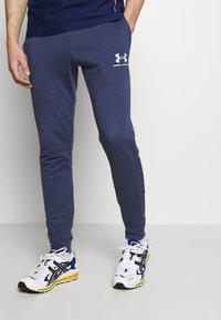 Under Armour - SPORTSTYLE - Tracksuit bottoms - blue ink/onyx white - 0