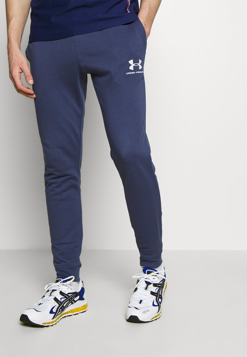 Under Armour - SPORTSTYLE - Tracksuit bottoms - blue ink/onyx white